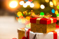 Closeup of Christmas gift boxes on the background of lights Royalty Free Stock Photo