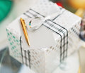 Closeup on christmas present box card and pen on table in living room Stock Image