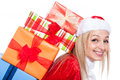 Closeup of christmas woman with many presents cute colorful isolated on white background Stock Photo