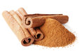 Closeup of cinnamon sticks and powder of ground cinnamon on white Royalty Free Stock Photo
