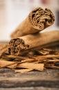 Closeup cinnamon sticks on wooden table selective focus Stock Photography