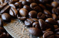 Closeup of coffee beans on vintage metal dish with ornament Royalty Free Stock Photo