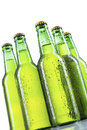Closeup of cold beer bottles with drops isolated on white background Stock Photo