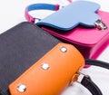 Closeup colored womans handbags Royalty Free Stock Photo