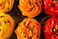 Closeup colorful chocolate fall decorated cupcakes Royalty Free Stock Photo