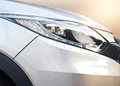 Closeup colorful headlights of car and vibrant background Royalty Free Stock Photo