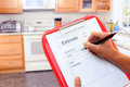 Closeup of a contractors clipboard as he writes up an estimate for a kitchen remodel shallow depth of field with focus on Royalty Free Stock Photography