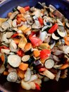 Closeup of courgettes, carrots, peppers, onion, aubergines and garlic cut ready to be cooked Royalty Free Stock Photo