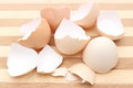 Closeup of cracked eggshell on wooden background Royalty Free Stock Photo