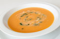 Closeup cream carrot soup white plate Royalty Free Stock Photo