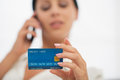 Closeup on credit card in hand of female Stock Photography
