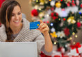 Closeup on credit card in hand of happy woman Royalty Free Stock Images