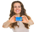 Closeup on credit card in hands of happy young woman Royalty Free Stock Image