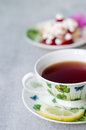 Closeup on cup of tea with sweet creamy cake on wooden table background Royalty Free Stock Photo