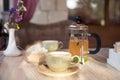 Closeup of cup of tea and teapot Royalty Free Stock Photo