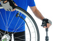 Closeup of a cyclist pumping up a bicycle tire man is unrecognizable and standing behind the wheel horizontal format over a white Royalty Free Stock Photography