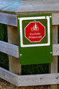 Closeup of a cyclists dismount sign on a fence
