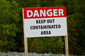 Closeup of a danger keep out of contaminated area sign Royalty Free Stock Photo