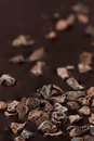 Closeup dark chocolate with pieces of cocoa beans Royalty Free Stock Photo