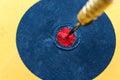 Closeup dart hitting on bullseye target Royalty Free Stock Photo