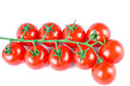 Closeup of a delicious red ripe cherry tomatoes on white with stem Stock Images