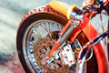 Closeup detail of a motorcycle s front wheel in traffic light Royalty Free Stock Image