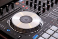 Closeup of dj controller with jog wheel and selective focus Royalty Free Stock Image