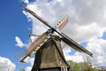 Closeup of a Dutch windmill, center connecting four wings Royalty Free Stock Photo
