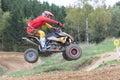 Closeup dynamic shot of quad rider jumping Royalty Free Stock Photo