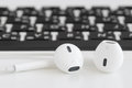 Closeup earbuds music accessories on laptop computer Royalty Free Stock Photo