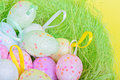 Closeup easter eggs in green nest Royalty Free Stock Photo