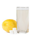 Closeup of effervescent tablets lemon and glass Stock Photo