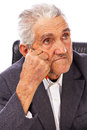 Closeup of an elderly man looking away in deep thought isolated on white background Stock Photo