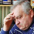 Closeup elderly man lost thought loneliness Royalty Free Stock Photo