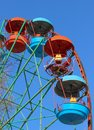Closeup of the empty cars of the stopped Ferris wheel amusement ride with the damaged cabin in the middle Royalty Free Stock Photo