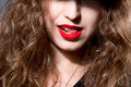 Closeup face of a beautiful girl with red lips woman licks her tongue hunter on the rich men Royalty Free Stock Photos
