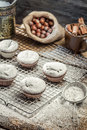 Closeup of falling powder sugar on fresh vanilla muffins old wooden table Royalty Free Stock Photo
