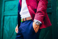 Closeup fashion image of luxury watch on wrist of man.body detail of a business man. Royalty Free Stock Photo