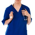 Closeup of female doctor s hand holding stethoscope over white background Stock Image