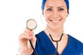 Closeup of female doctor s hand holding stethoscope over white background Royalty Free Stock Image