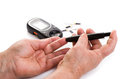 Closeup female hands using glucometer scanner Royalty Free Stock Photo