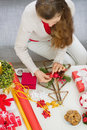 Closeup on  female making Christmas decorations Royalty Free Stock Photos
