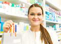 Closeup of a female pharmacist holding packet at drugstore Royalty Free Stock Photo