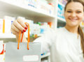 Closeup of a female pharmacist holding packet in her hand at dru Royalty Free Stock Photo