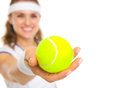 Closeup on female tennis player giving tennis ball isolated white Royalty Free Stock Image