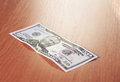 Closeup of fifty dollar bills on wooden table Royalty Free Stock Photo