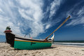 Closeup of fishing boat pulled up on beach Royalty Free Stock Photo