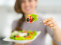 Closeup on fork with salad in hand of woman Royalty Free Stock Photo