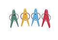 Closeup four multi colored plastic clothespegs located vertically image isolated white file includes clipping path Stock Image