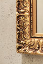 Closeup of a frame decorative gold mirror Stock Image